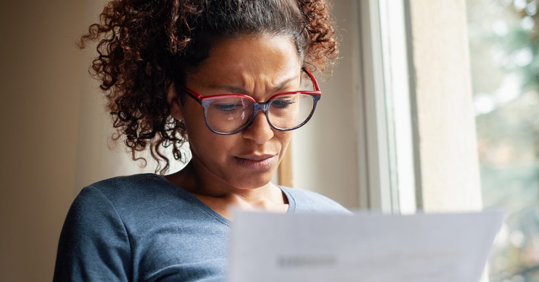 Woman looks at a document.