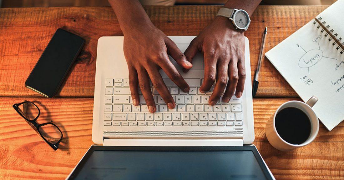 Individual using a laptop