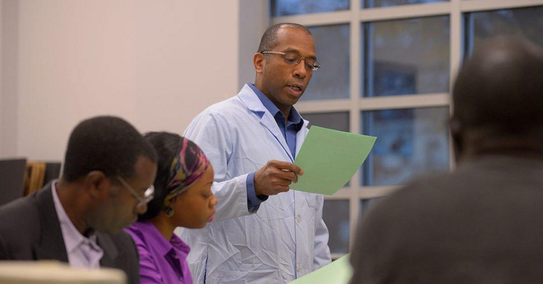 Man talking at a community meeting