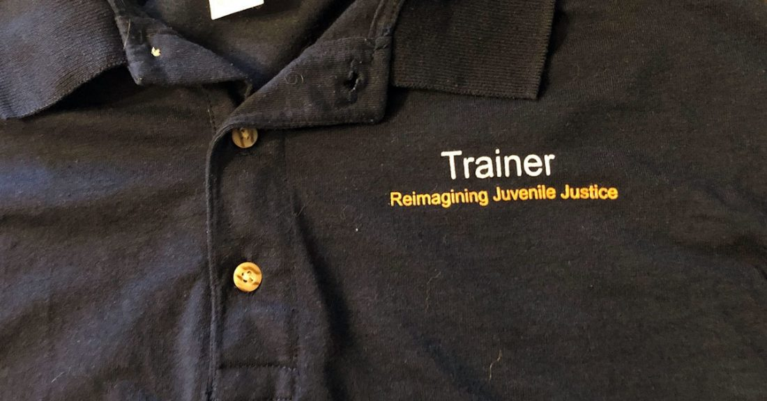 A shirt from the Reimagining Juvenile Justice train-the-trainer program