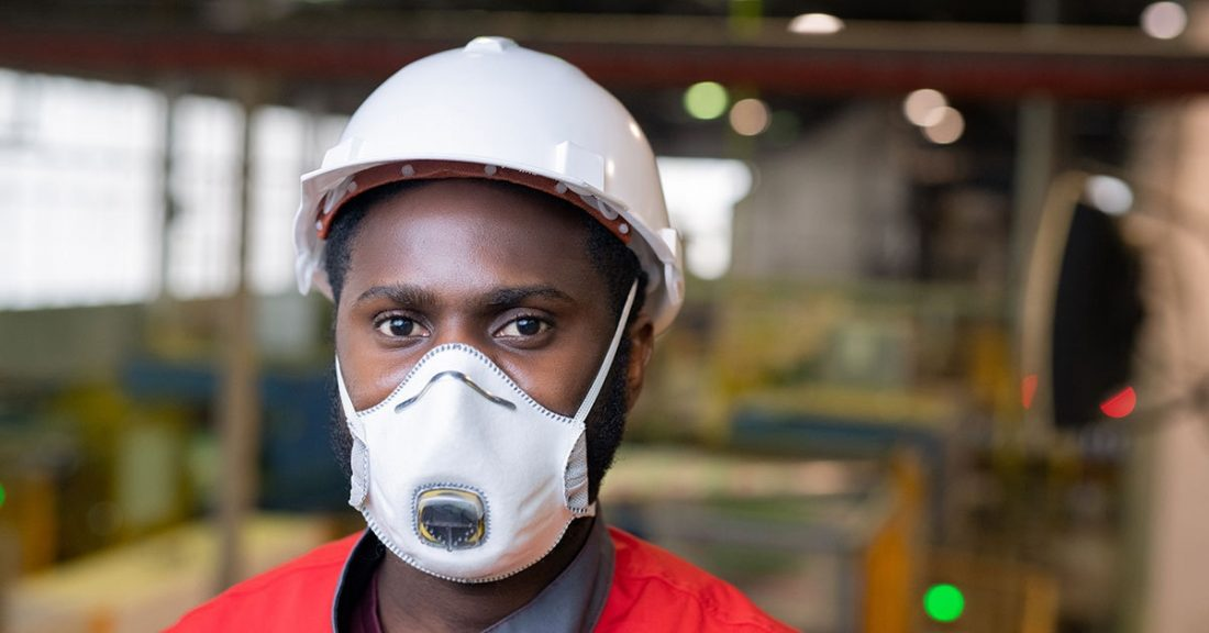 Young person working while wearing a face mask