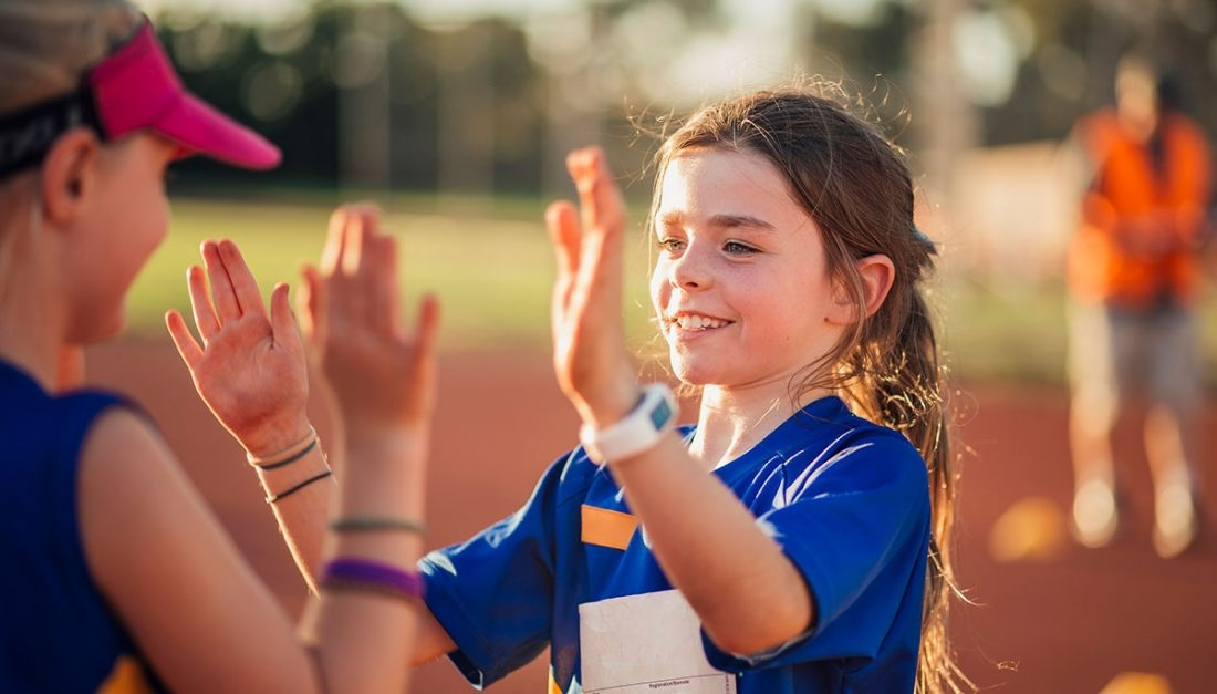 A young girl finds success on the baseball field with her friend.