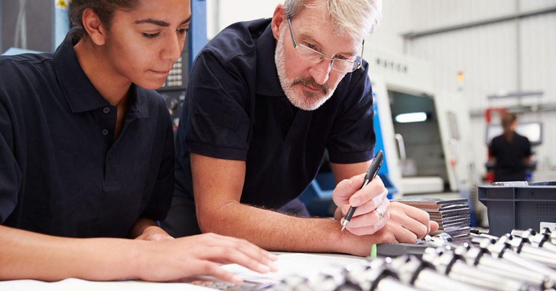 An employer helps train a new employee