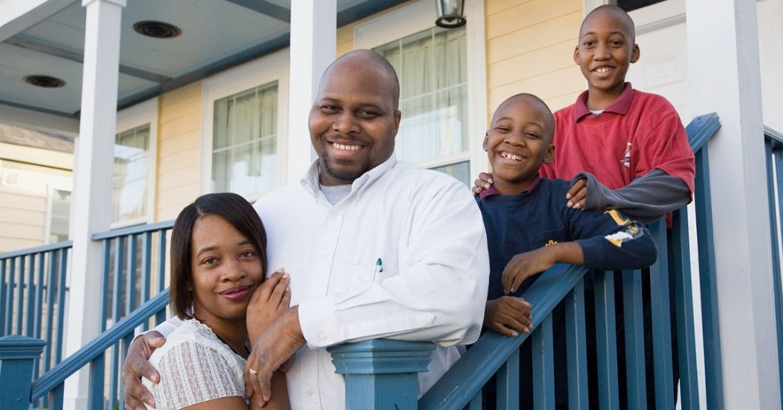 Family on porch of house in Atlanta
