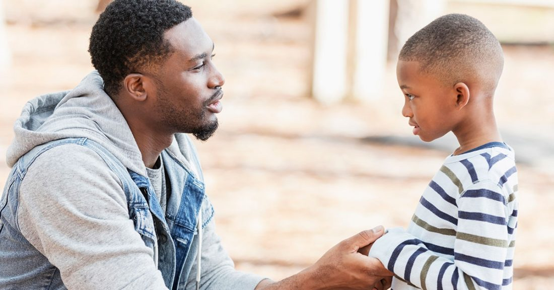 Father talks with young son