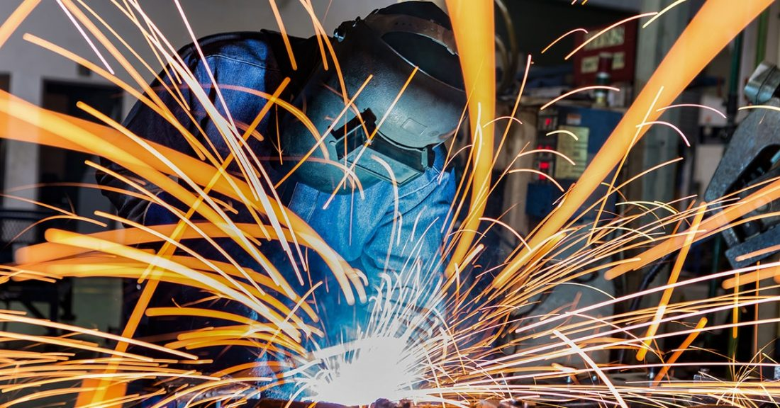 Young person learning a trade in a manufacturing job