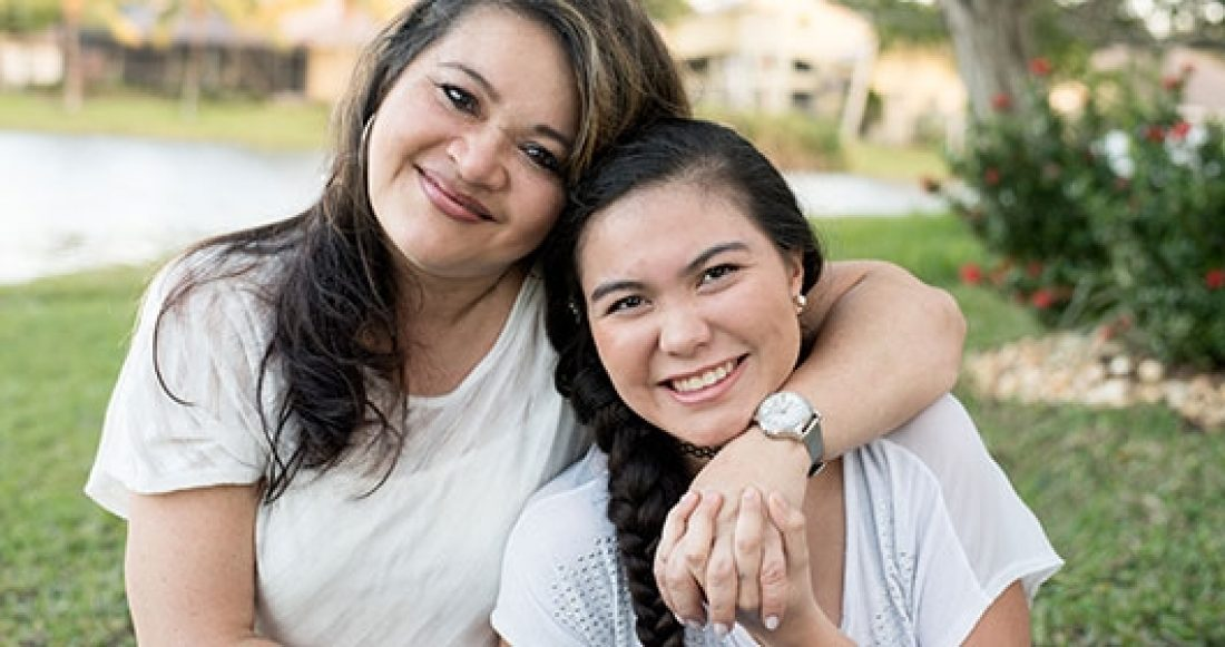 Hispanic mother and daughter. More than half of kids in immigrant families grow up in low-income households.