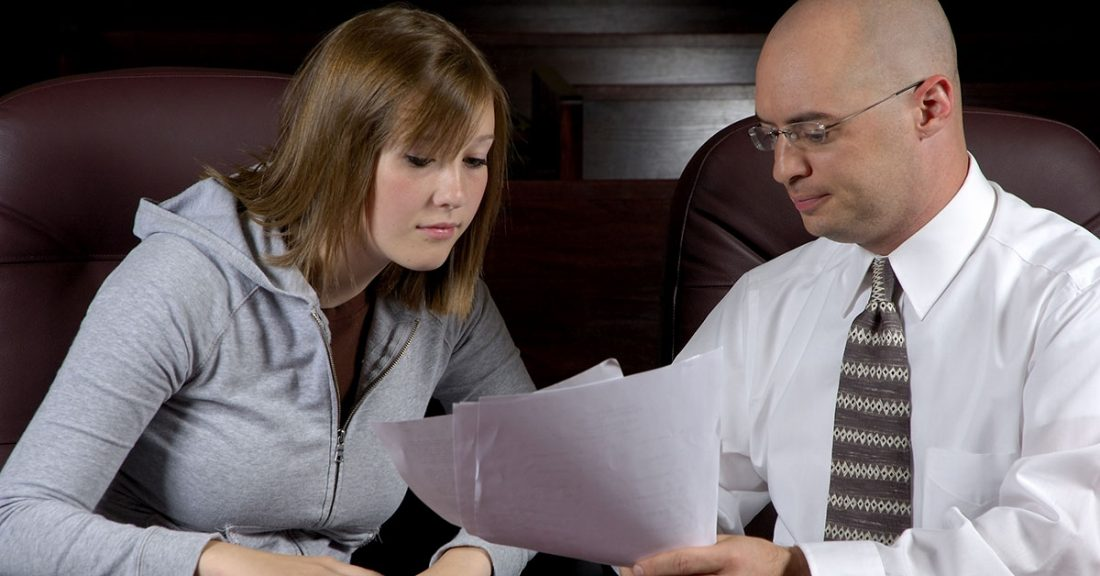 Young person talking with an attorney