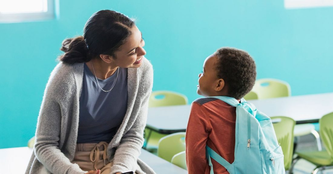 Caseworker talks with a child as part of an investigation