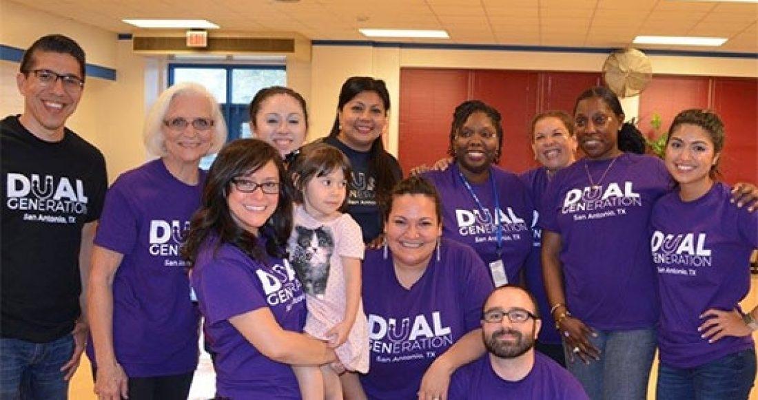 Henrietta Muñoz (holding child) and staff from Dual Generation Partnership