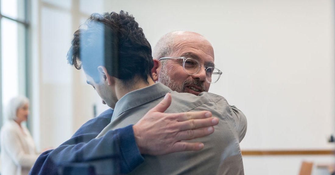 Man gives a hug