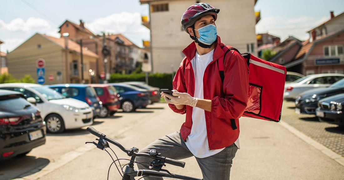 Young person making deliveries during the COVID-19 pandemic.